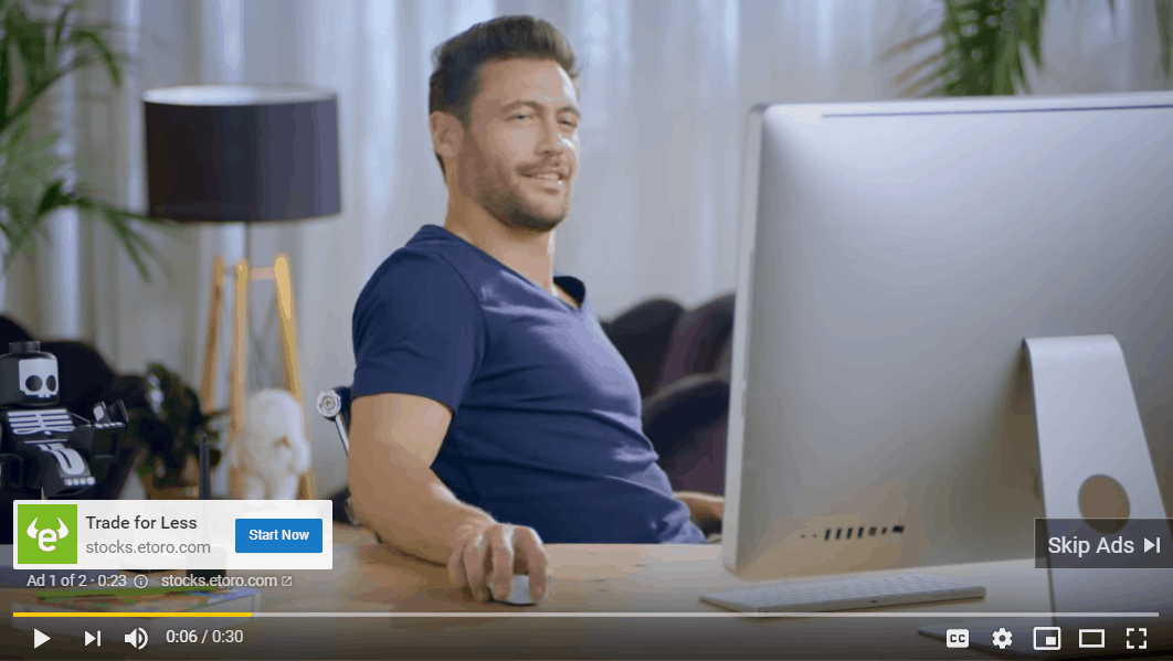 Example of a YouTube pre-roll ad white male in blue t-shirt sitting at his desk