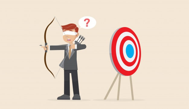 Businessman with bow and arrow and target, off the mark