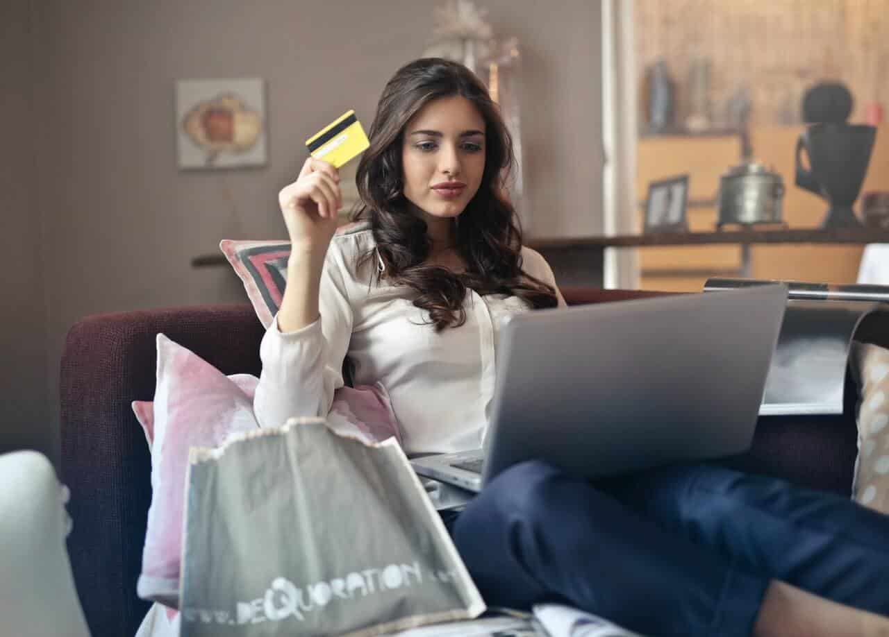 Lady shopping online with credit card- online advertising & PPC